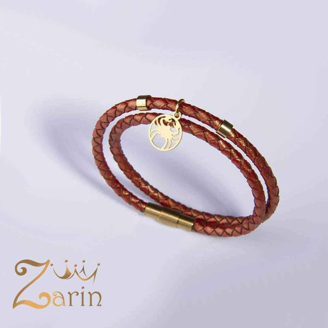دستبند طلا طرح ماه تولد تیر با چرم بافت