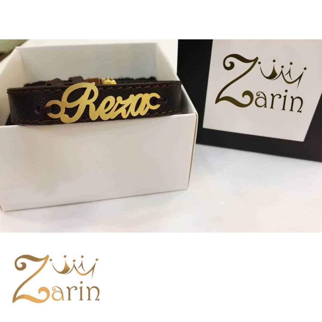 """دستبند چرم طلا با  فونت انگلیسی اسم """"رضا"""""""