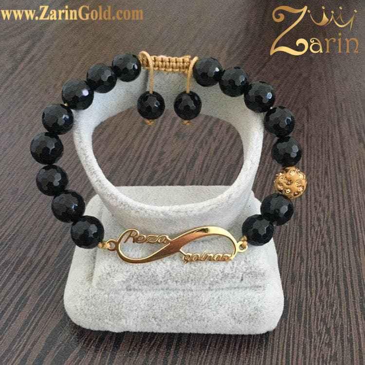 دستبند طلا طرح بینهایت با اسامی رضا و سولماز